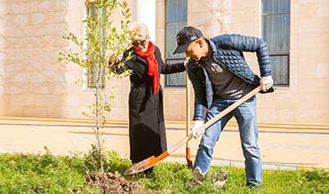 he participants of eco-marathon planted trees near the Kazakh National Academy of Choreography